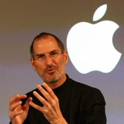 Steve Jobs in front of Apple Logo