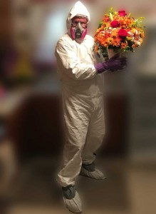 Tim in Hazmat Suit with Flowers